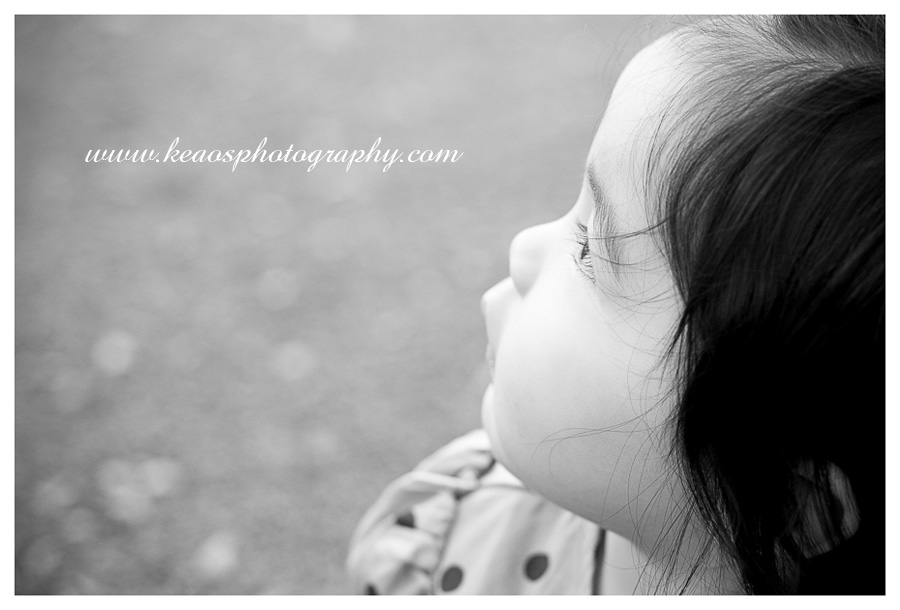 black and white photo of a baby girl