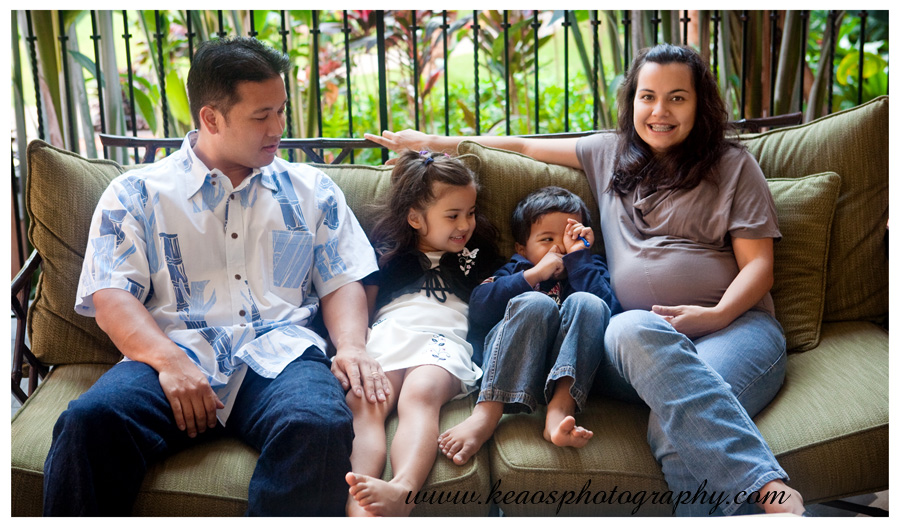 family sitting on couch laughing