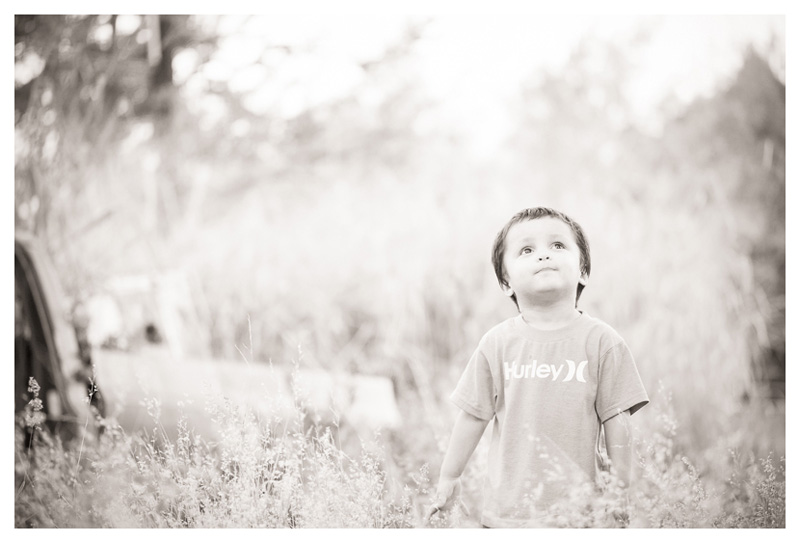 b/w Big Island Hawaii Photograph of boy in wild field by Big Island Hawaii Photographer