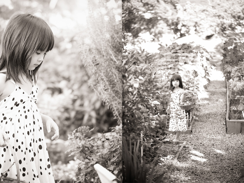 black and white photo of little girl in Foster Botanical Garden