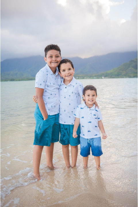 three brothers on Oahu smiling for photo